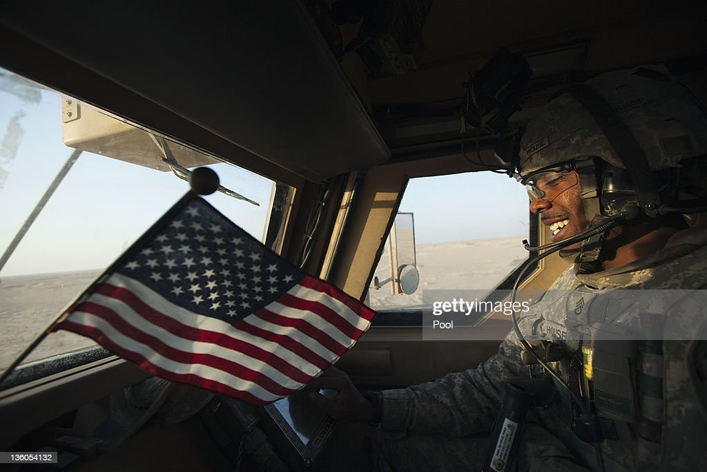 Staff Sergeant Prince House with the 3rd Brigade Combat Team, 1st Cavalry Division smiles as his Mine Resistant Ambush Protected (MRAP) vehicle nears the Kuwaiti border as part of the last U.S. military convoy to leave Iraq on December 18, 2011 near Nasiriyah, Iraq. All U.S. troops were scheduled to have departed Iraq by December 31st, 2011. At least 4,485 U.S. military personnel died in service in Iraq. According to the Iraq Body Count, more than 100,000 Iraqi civilians have died from war-related violence.