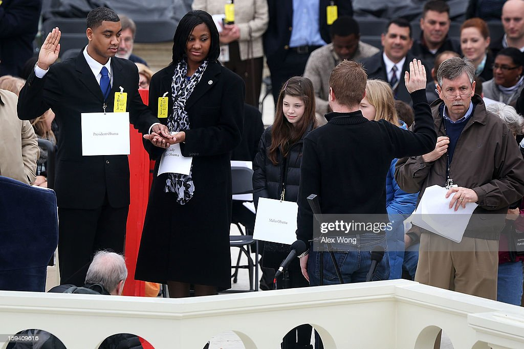 Staff Sergeant Serpico Elliott (L) and Specialist Delandra Rollins stand in as U.S. President Barack Obama and first lady Michelle Obama during an inauguration rehearsal at the U.S. Capitol, on January 13, 2013 in Washington, DC. President Barack Obama and Vice President Joe Biden will be ceremonially sworn in for a second four-year term during the 57th Inauguration on January 21.