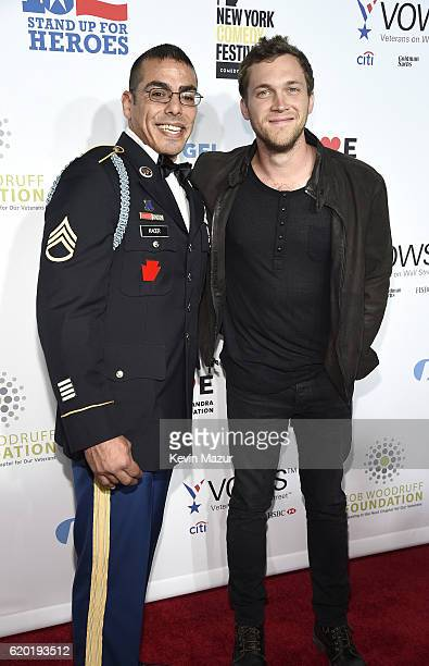 Staff Sergeant US Army Michael Kacer and singer songwriter Phillip Phillips attend as The New York Comedy Festival and The Bob Woodruff Foundation...