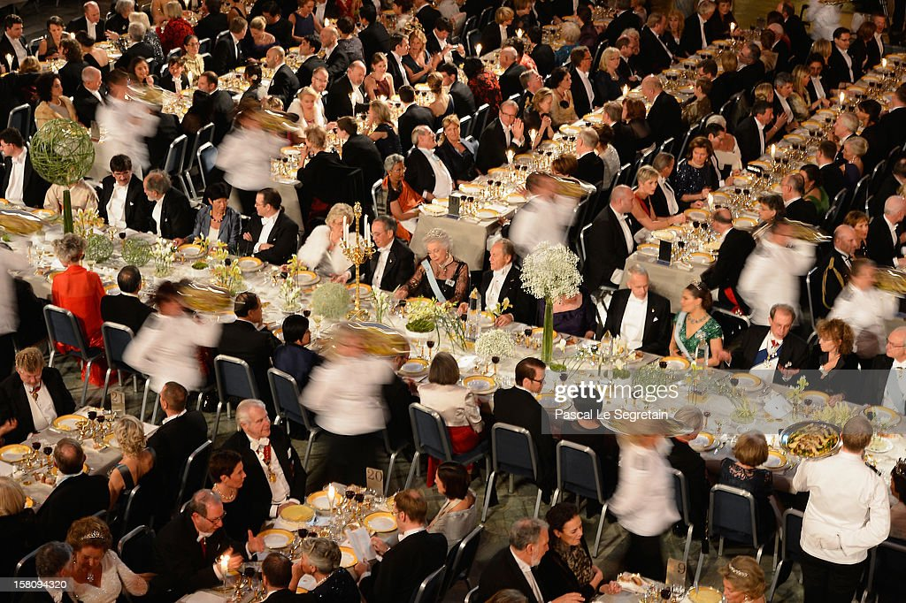 Staff serve guests at the main table during the Nobel Banquet after the 2012 Nobel Prize Ceremony at Town Hall on December 10, 2012 in Stockholm, Sweden.