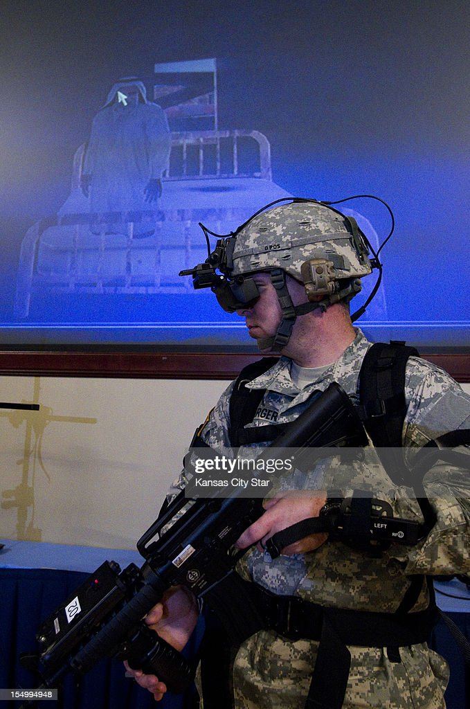 Staff Sgt. Donald Kimzey identifies and secures the high-value target while demonstrating the immersive training system in Marshall Auditorium of the Lewis and Clark Center on Fort Leavenworth, October 25, 2012, in Leavenworth, Kansas. Soldiers test their skills walking virtual battlefields.