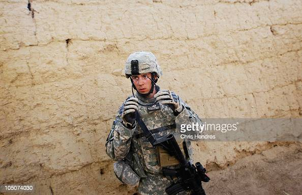 Staff Sgt Dustin Shanahan of Susanville California with US Army's EOD demolition team pauses during a day when he was called upon to defuse four...