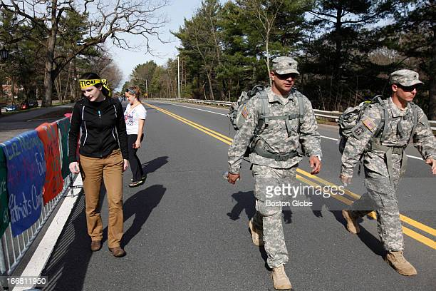 Staff Sgt Mark Welch right of Taunton and Spc Jorge Pacheco of New Bedford walk along the route for the Army National Guard carrying 35 lbs of...