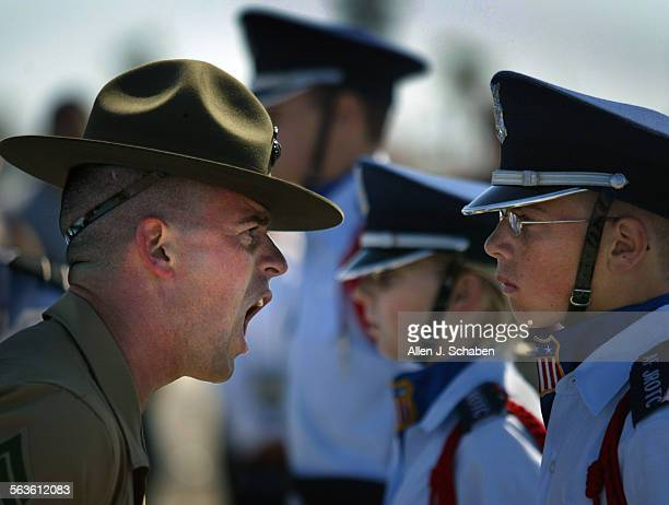 Staff Sgt Rodney Cantrell a senior drill sergeant instructor with the Marine Corps Recruit Depot San Diego shouts criticism at Adam Weaver of the...