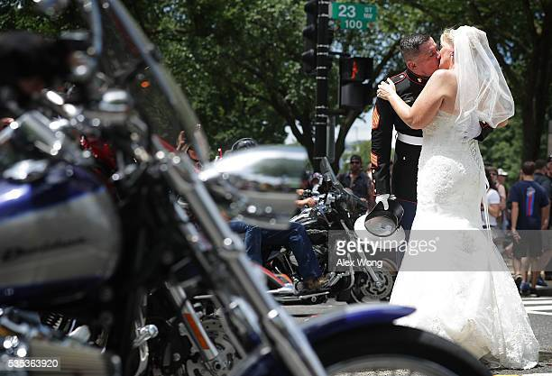 Staff Sgt Tim Chambers the saluting Marine kisses his bride Lorraine Heist during the annual Rolling Thunder First Amendment Demonstration Run May 29...