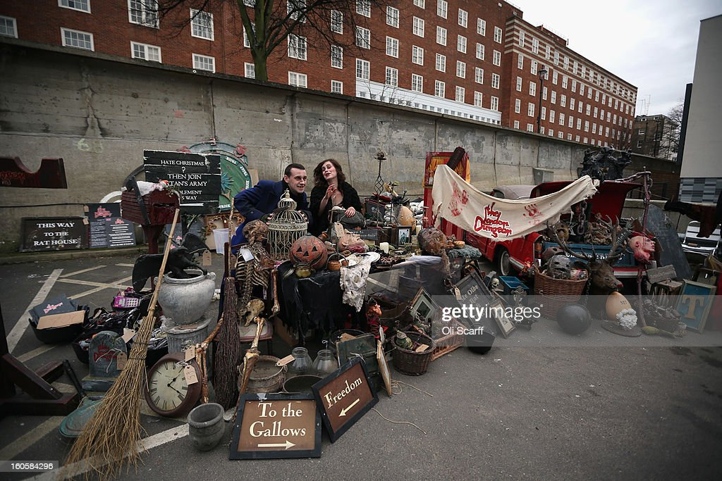 Staff stand next to props previously used in 'The London Dungeon' which are to be sold at a car boot sale in Pimlico as the attraction prepares to move to new premises on the Southbank, on February 3, 2013 in London, England. The sale features a selection of torture and surgical implements, costumes, plague doctor's potions, false eyeballs, severed limbs, and a set of stocks. The London Dungeon will reopen in March 2013 in larger premises on the Thames' Southbank, having moved from Tooley Street where it originally opened 38 years ago.