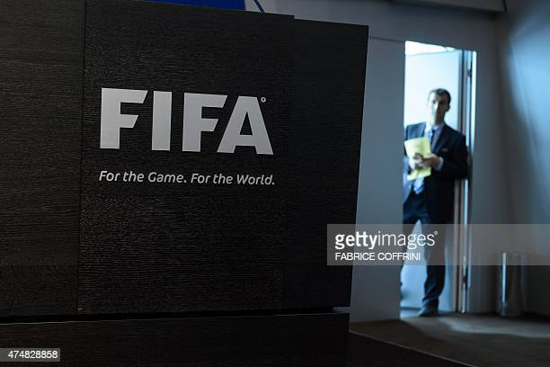 A staff waits prior to a press conference at the FIFA heaquarters on May 27 2015 in Zurich Swiss police on Wednesday raided a Zurich hotel to detain...