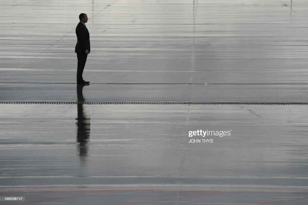 A staff waits upon arrival of US President for the G7 summit on June 4, 2014 at Brussels' airport.