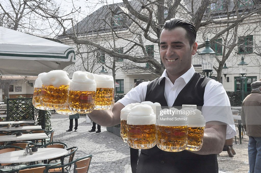 Staff with beer during the opening of Schweizerhaus Wien on March 15, 2013 in Vienna, Austria.