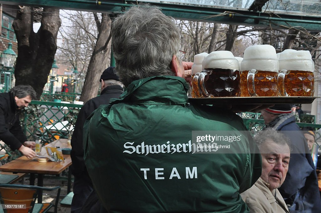 Staff with tray and beer during the opening of Schweizerhaus Wien on March 15, 2013 in Vienna, Austria.