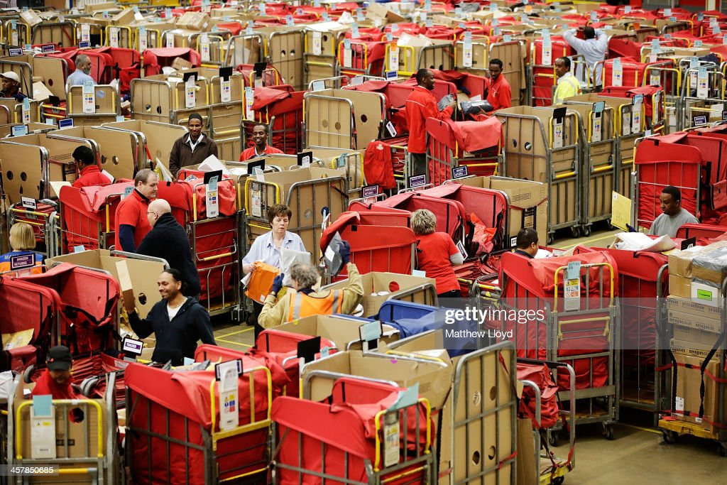 Staff work in the packet and parcel section of the Royal Mail's Swan Valley mail centre on December 18, 2013 in Northampton, England. This Friday the 20th is the last day for first class mail for Christmas. This will be the first Christmas since privatisation, Royal Mail is also set to join the FTSE 100 only two months since its debut.