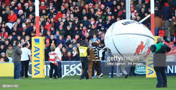 Staff work on the posts after kick off is delayed after an inflatable rugby ball knocks down the crossbar for the posts before the Aviva Premiership...