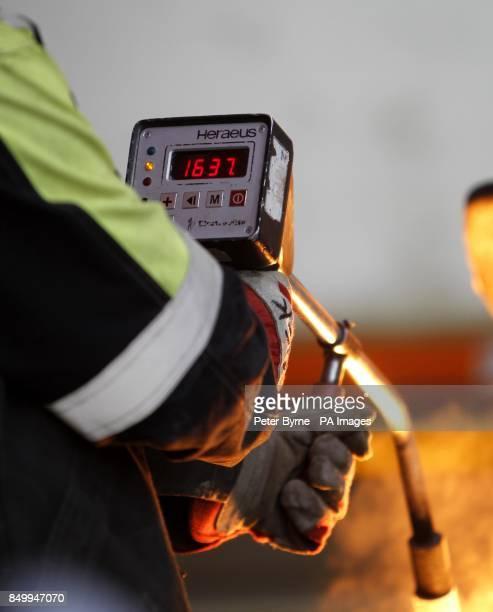 A staff worker at Bonds Precision Castings in Alston Cumbria checks the temperature of Molten Steel in Celcius