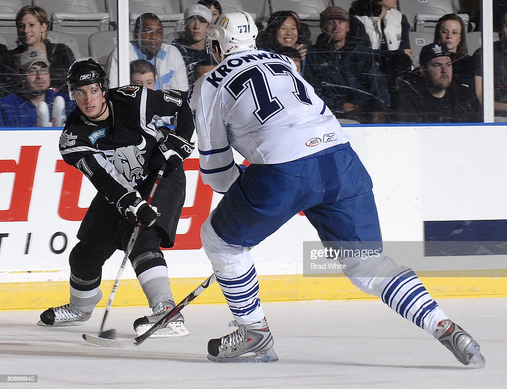 Staffan Kronwall of the Toronto Marlies battles for the puck with David Spina of the San Antonio Rampage April 16 2007 at the Ricoh Coliseum in...