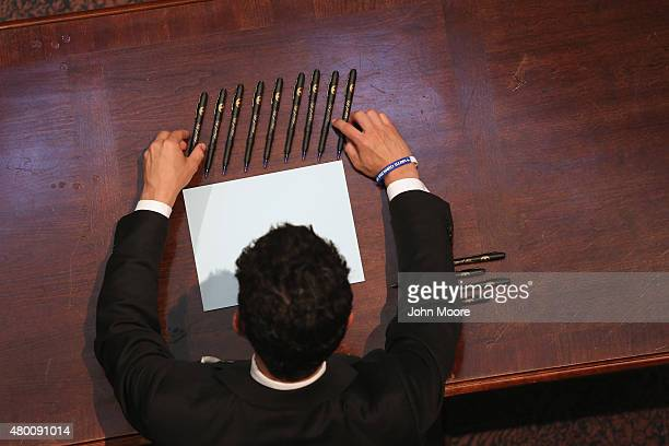 A staffer arranges pens ahead of a ceremony where Governor Nikki Haley was to sign a bill removing the Confederate flag from outside the statehouse...