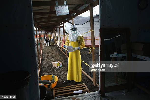 A staffer for Doctors Without Borders stands in protective clothing in the high risk area of the new MSF Ebola treatment center on August 21 2014...