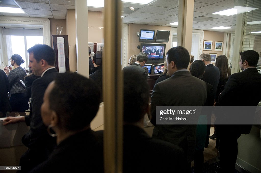 Staffers and journalists overflow from a news conference to announce bi-partisan agreement on the principals on a comprehensive immigration reform bill.