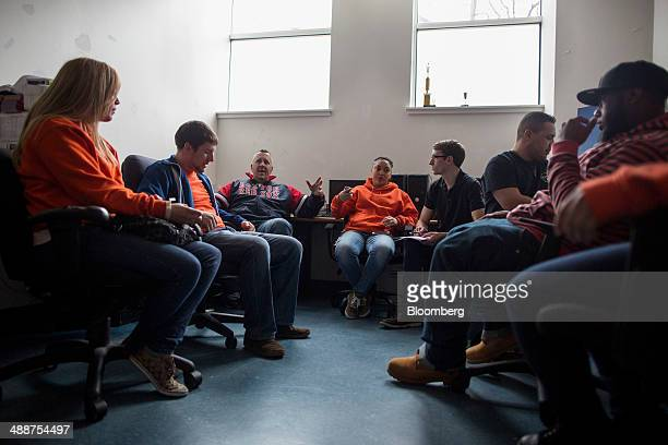Staffers at Roca attend a meeting at their offices in Chelsea Massachusetts US on April 15 2014 Goldman Sachs Group is anchoring a $21 million plan...