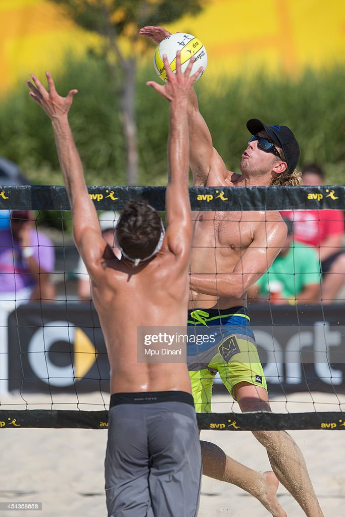 Stafford Slick (R) spikes the ball against Andrew Dentler (L) at the 2014 AVP Cincinnati Open on August 29, 2014 at the Lindner Family Tennis Center in Cincinnati, Ohio.