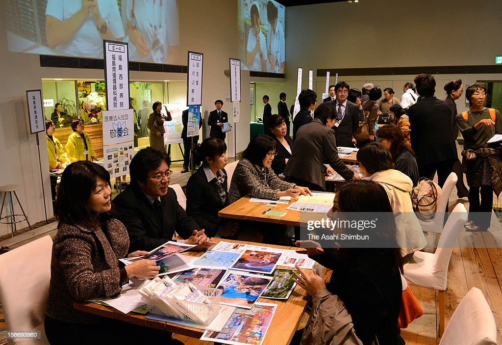 Staffs of hospitals in Fukushima interview nurses and students at an Fukushima Nurse Job Fair at recruiting agency Pasona headquarters on November 18, 2012 in Tokyo, Japan. 90 particpants listen to the benefits of 25 Fukushima hospitals that are in serious nurse shotage, partly because nurses having small children have left Fukushima worrying their children's health.