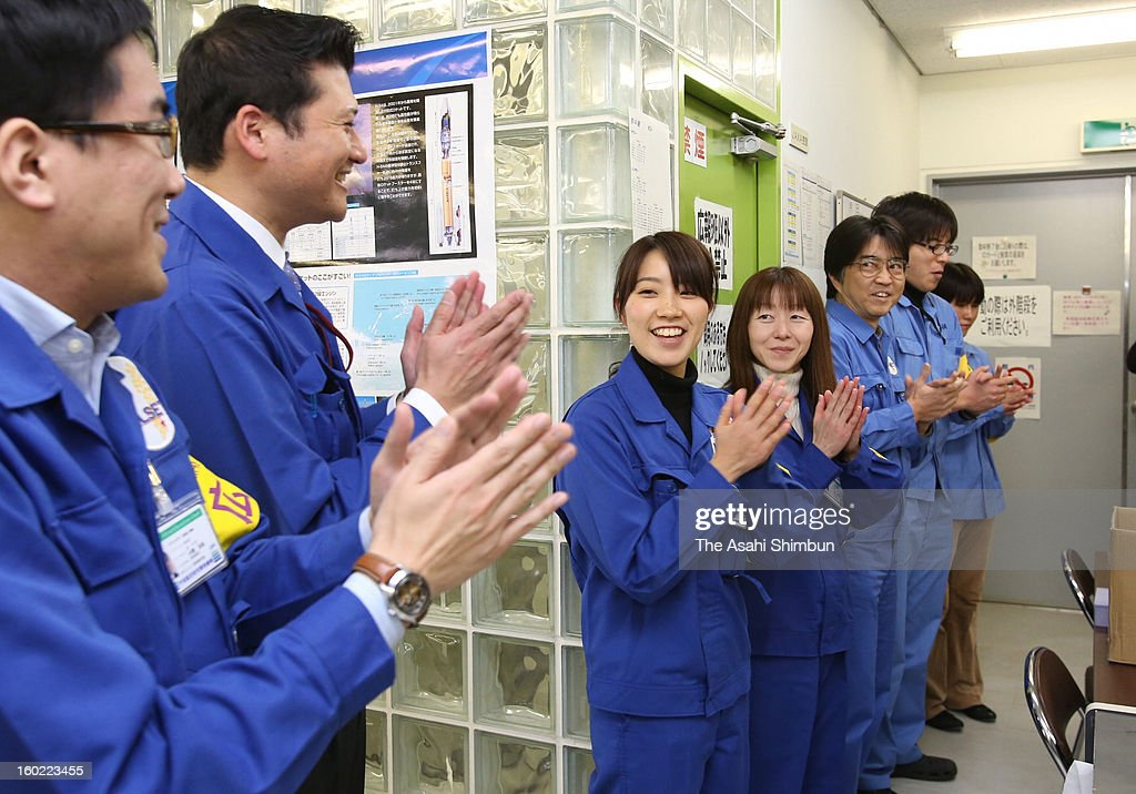 Staffs of the Japan Aerospace Exploration Agency (JAXA) and Mitsubishi Heavy Industries Ltd. celebrates the launch of H2A-22 rocket at JAXA's Tanegashima Space Center on January 27, 2013 in Minamitane, Kagoshima, Japan. The rocket carries information-gathering radar satellite and optical satellite.