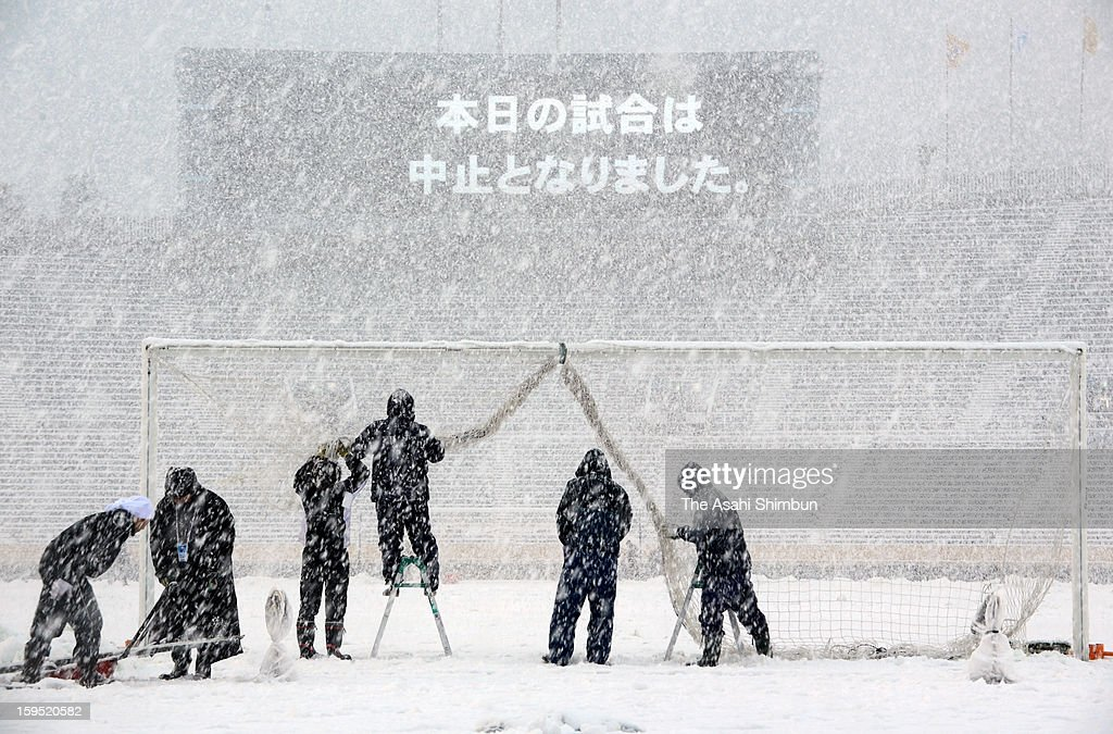 Staffs remove the goal net as the All Japan High School Football Championship Final was postponed at the National Stadium on January 14, 2013 in Tokyo, Japan. A strong low pressure system caused heavy snow and strong wind in the coast area including Tokyo, more than 500 injured.