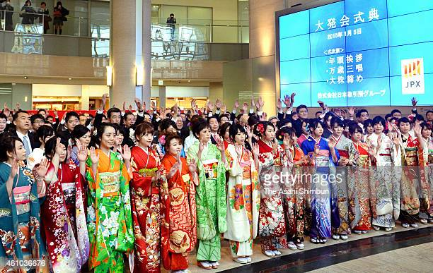 Staffs wearing kimonos attend the 'Daihakkai' ceremony to make the first trading day of hte year at the Osaka Securities Exchange on January 5 2015...