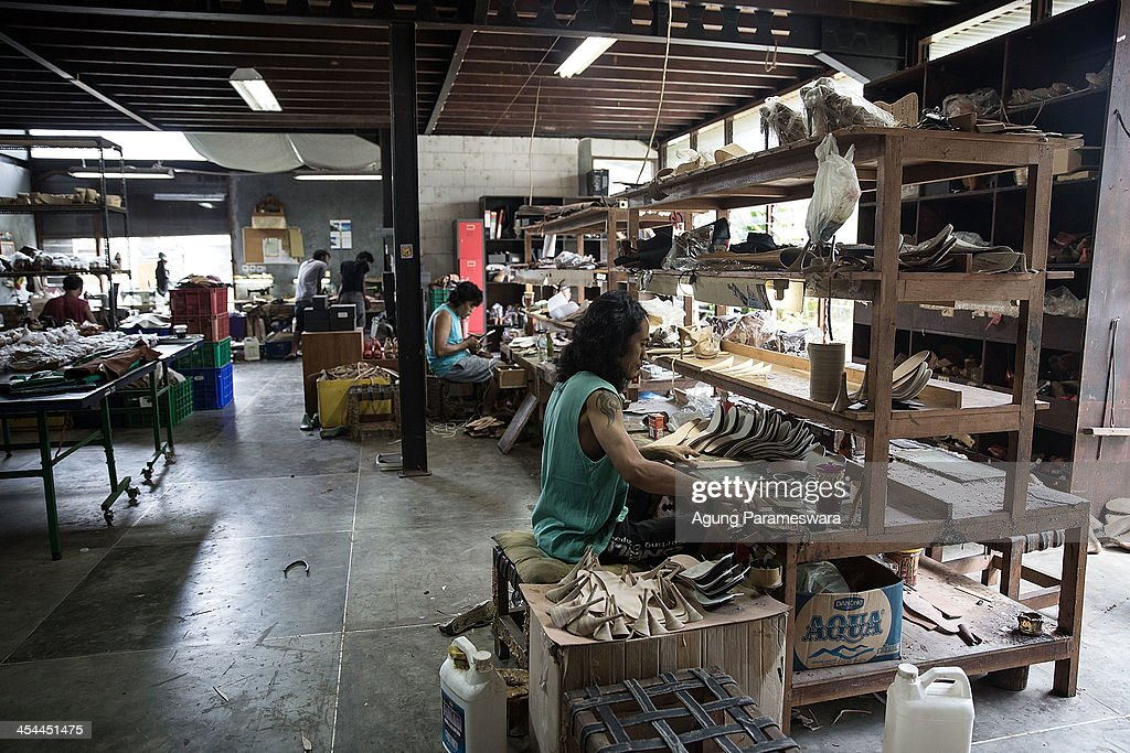 Staffs work at Niluh Djelantik atelier on November 12, 2013 in Canggu Village, Bali, Indonesia. Niluh Djelantik (formerly called Nilou), the hand made high end leather shoe, is produced by Balinese shoe lover and designer Ni Luh Ayu Pertami with 40 shoes designers and workers in a small atelier at Canggu Village. This brand signature by a unique engraving and designed to be comfortable high heels or wedges with elegan touch. Celebrities like Cate Blanchett, Uma Thurman,Julia Roberts ,Paris Hilton, Cameron Diaz and American top model Gisele Bundchen have been known to purchase Niluh Djelantik beautiful shoes and sandals.