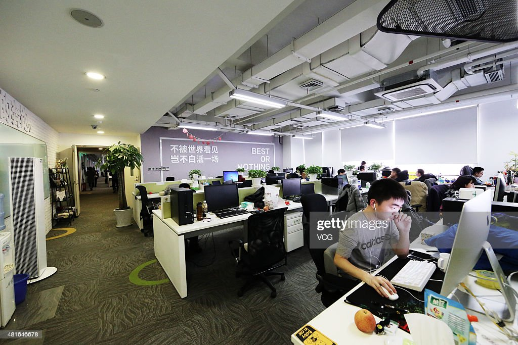 Staffs work in offcie area of Qihoo 360 Technology Co Ltd on March 10 2015 in Beijing China Qihoo 360 Technology Co Ltd is a leading Chinese supplier...