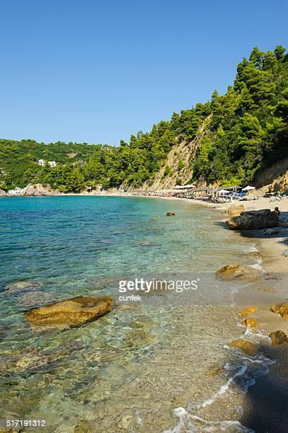 Stafylos beach with rocks in water Skopelos