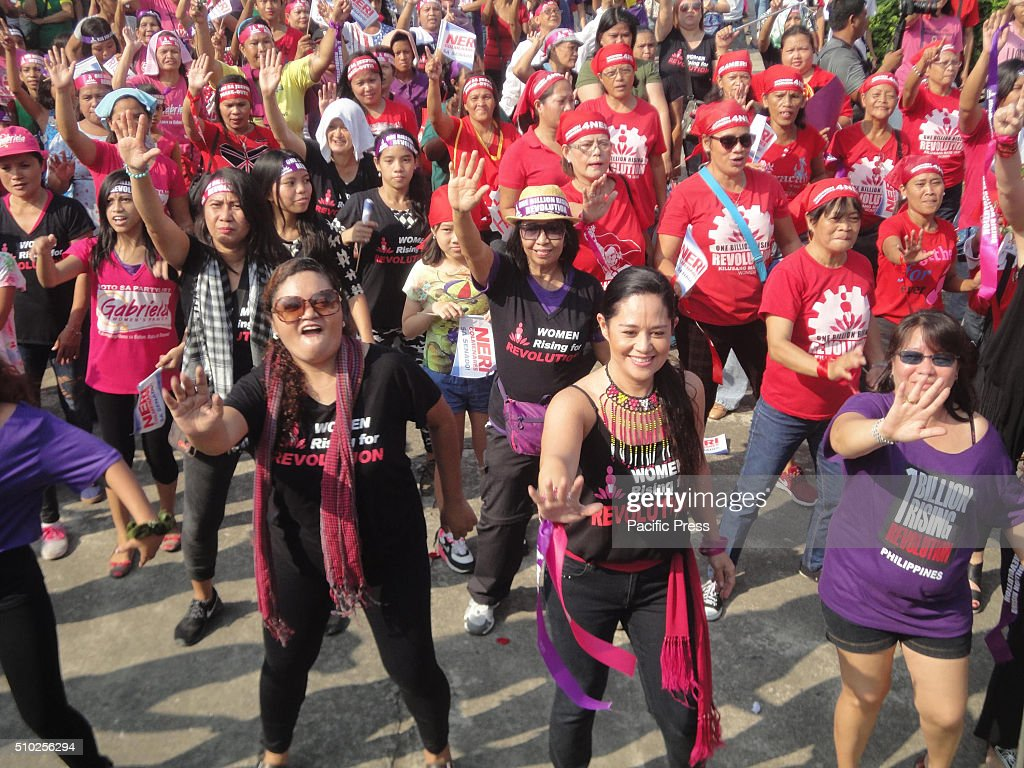 Stage actress Monique Wilson, center right, participates in a global campaign called 'One Billion Rising' at the Luneta Park. This year's theme is 'Escalating Revolution.'.