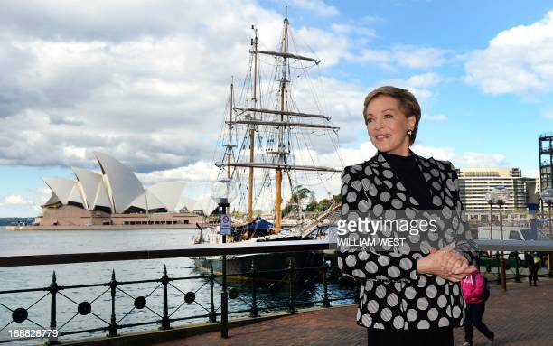 Stage and screen icon Julie Andrews poses for photos in front of the Sydney Opera House during her first visit to Australia on May 16 2013 The star...
