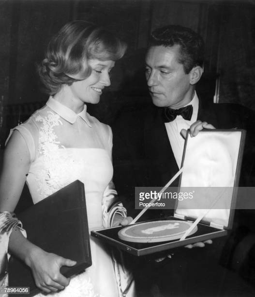Stage and Screen Personalities London pic 12th July 1957 The British Film Academy Awards Virginia McKenna and Peter Finch with their BAFTA awards...