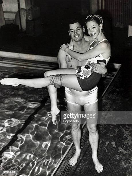 16th February 1948 USactor and former Olympic swimming champion Johnny Weissmuller pictured at a London swimming pool with one of the swimmers...