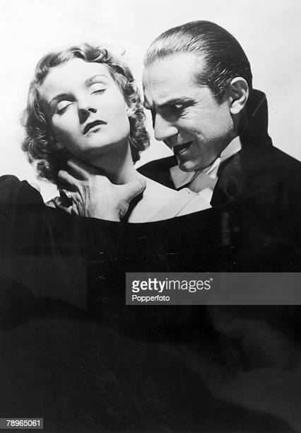 1931 Hungarian born actor Bela Lugosi in the 1931 production of 'Dracula' in threatening pose with young lady