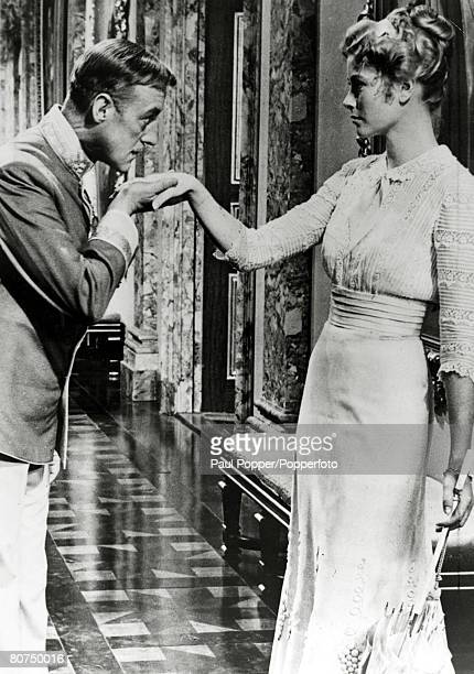 1955 American actress Grace Kelly with British actor Alec Guiness in the film 'The Swan' Grace Kelly born in Philadelphia was a cool elegant beauty...