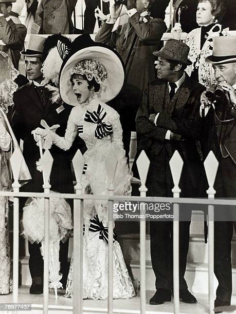 1964 Actress Audrey Hepburn in the film 'My Fair Lady' with Rex Harrison and Wilfred Hyde White right Audrey Hepburn born in Brussels a truly...