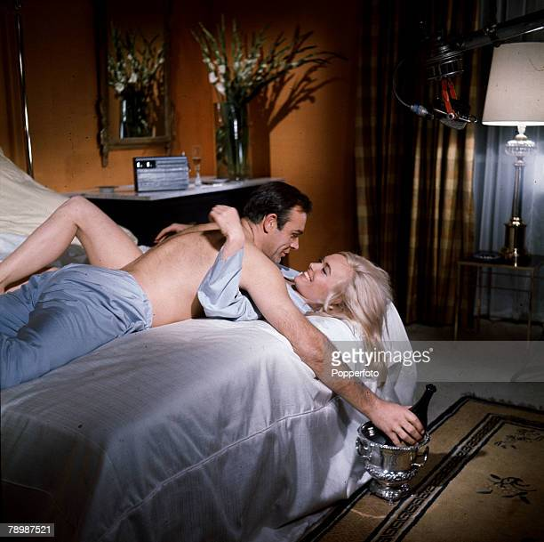1964 Sean Connery playing the James Bond character and Shirley Eaton as Jill Masterson in a love scene from the film 'Goldfinger'
