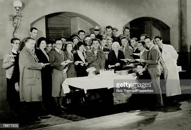 circa 1931 Mexico born actor Ramon Novarro pictured centre with the team of the film 'Daybreak' as he celebrates his birthday