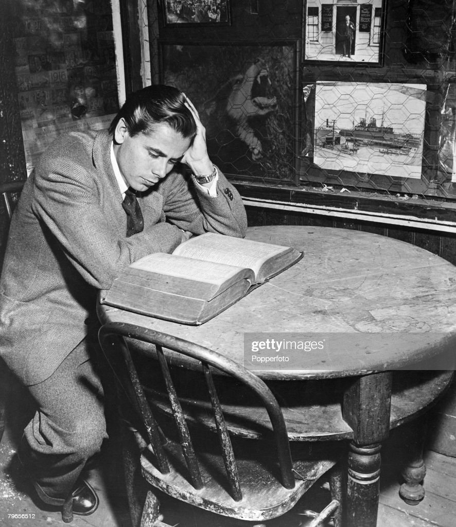 circa 1942 American actor Glenn Ford who played the title role in the fim 'Adventures of Martin Eden' pictured inside the 'First and Last Chance...
