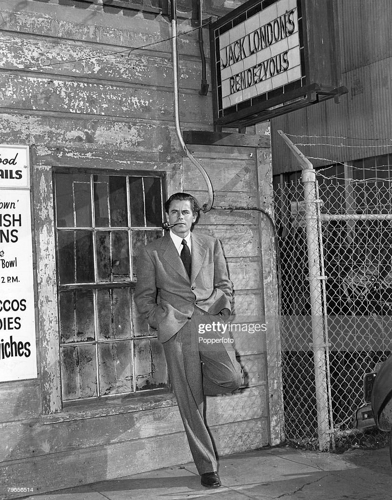 circa 1942 American actor Glenn Ford who played the title role in the fim 'Adventures of Martin Eden' pictured outside the 'First and Last Chance...