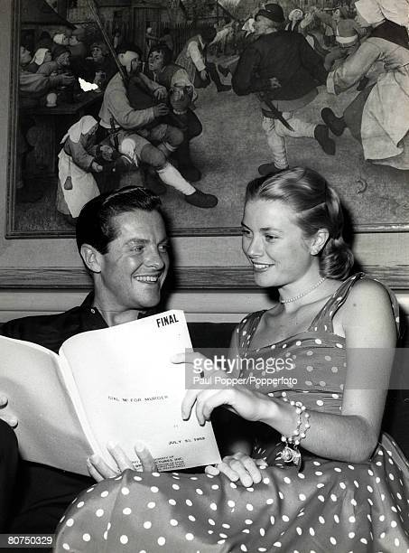 circa 1950 American actress Grace Kelly reading over a script with actor Robert Cummings Grace Kelly born in Philadelphia was a cool elegant beauty...
