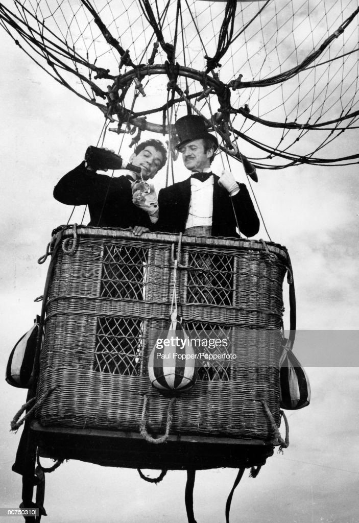 circa 1956, British actor David Niven, right, playing 'Phileas Fogg' with Cantinflas playing 'Passepartout' in the film 'Around The World In Eighty Days'