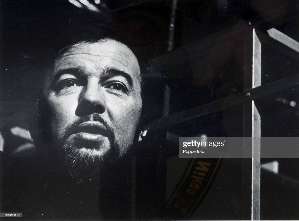 circa 1975, English theatre, opera and film director Peter Hall, born 1930, pictured in moody dark setting, Peter Hall was knighted in 1977