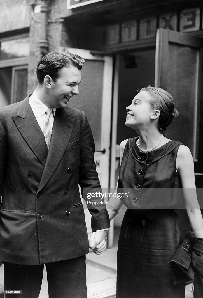 July 1956, English theatre, opera and film director Peter Hall pictured with French actress Leslie Caron at the time they announced their engagement, Peter Hall was knighted in 1977