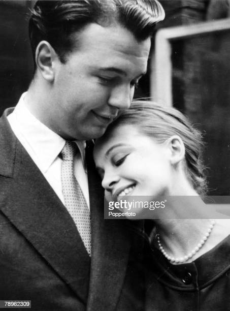 July 1956 English theatre opera and film director Peter Hall pictured with French actress Leslie Caron at the time they announced their engagement...
