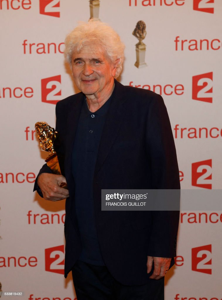 Stage director Alain Francon poses after receiving the Moliere Award for the best director in a private theatre during the 28th Ceremony of the French Theatre Molieres awards at the Folies Bergers in Paris, on May 23, 2016. GUILLOT