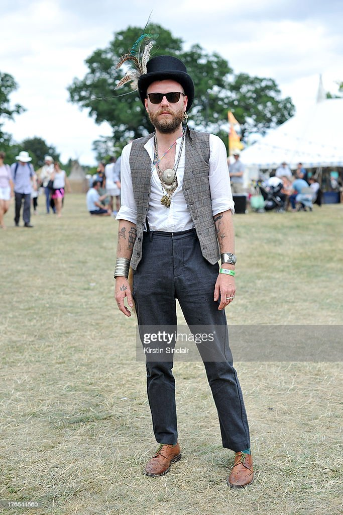 Stage director and PR Nathan Woodhead wears a Secret Emporium hat, Hugo Boss trousers, vintage shirt, Bertie shoes, Mango Waistcoat and jewellery from Morrocco on day 3 of Wilderness Festival on August 10, 2013 in Cornbury Park, Oxfordshire, England.