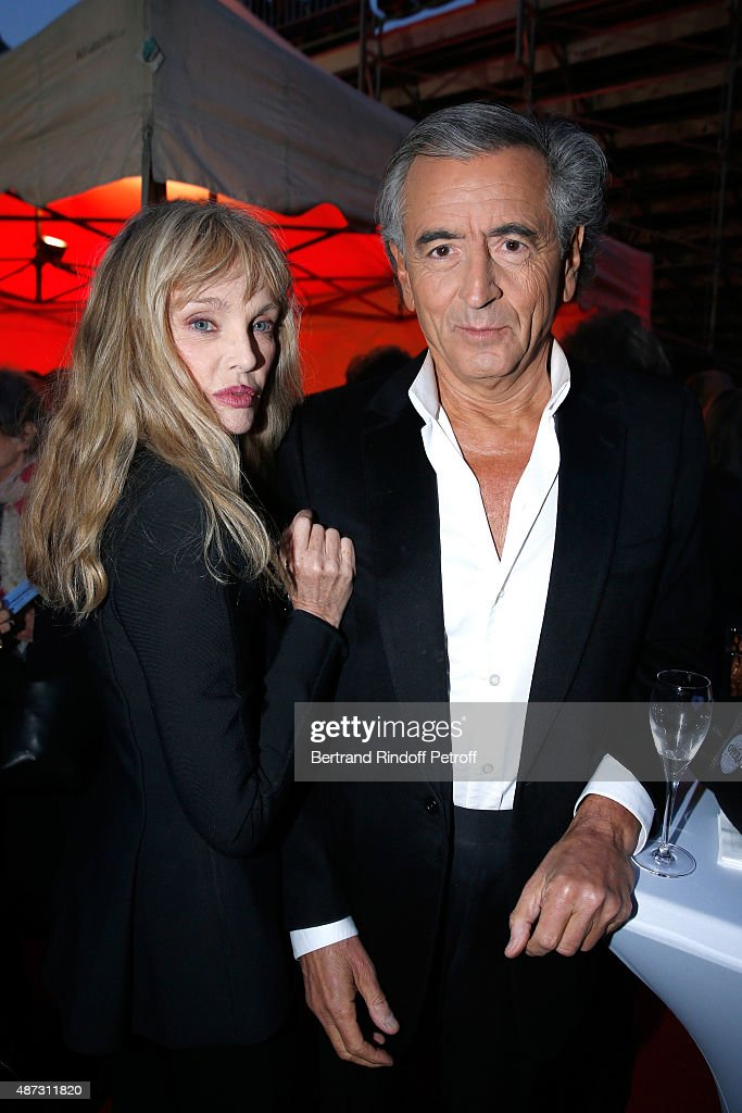 Stage Director of the Opera <a gi-track='captionPersonalityLinkClicked' href=/galleries/search?phrase=Arielle+Dombasle&family=editorial&specificpeople=616903 ng-click='$event.stopPropagation()'>Arielle Dombasle</a> and her husband Writer Bernard-Henri Levy attend 'La Traviata' - Opera en Plein Air, produced by Benjamin Patou and 'Moma Event'. Held at Hotel Des Invalides on September 8, 2015 in Paris, France.