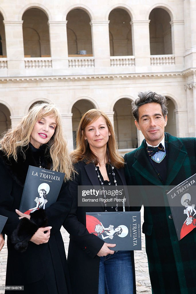 Stage Director of the Opera <a gi-track='captionPersonalityLinkClicked' href=/galleries/search?phrase=Arielle+Dombasle&family=editorial&specificpeople=616903 ng-click='$event.stopPropagation()'>Arielle Dombasle</a>, Music Booking Opera <a gi-track='captionPersonalityLinkClicked' href=/galleries/search?phrase=Anne+Gravoin&family=editorial&specificpeople=8536985 ng-click='$event.stopPropagation()'>Anne Gravoin</a> and sets and costumes of the Opera Vincent Dare attend the Opera 'La traviata', 'Opera en plein Air 2015' : Press Conference. Held at Invalides on March 13, 2015 in Paris, France.